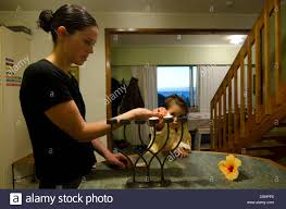 young jewish mother and her daughter lights and bless on the