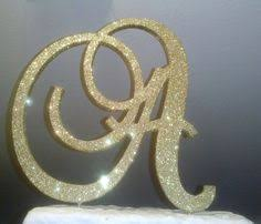 gold monogram cake toppers monogram cake topper 5 inch gold glitter by itsinglitter on etsy