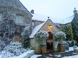the entrance to calcot manor looking enchanting in the snow a
