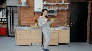 happy listening to in kitchen wearing