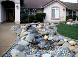 Rock Backyard Landscaping Ideas by Neutral Cream House Painting Designed Before Front Yard Garden