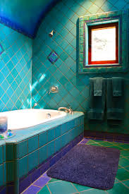 bathroom soaking tub in great eclectic bathroom design with teal