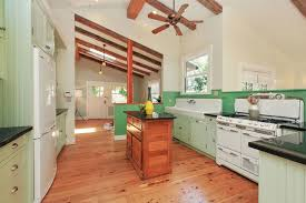 back to back sinks green backsplash and slanted ceiling ideas with wooden beams using