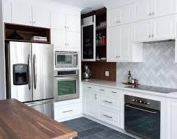 cuisine blanc et noyer métamorphose réno de cuisine sombre à cuisine luxueuse avant après
