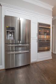 new fridge and double oven wall with shaker style panels and