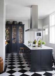 white kitchen cabinets black tile floor 40 black and white floor tile for your kitchen
