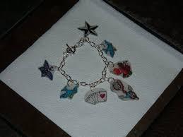 tattoo blog charm bracelet tattoos