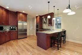 cherry wood kitchen island kitchen in luxury home with cherry wood cabinetry stock photo