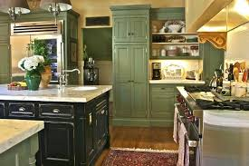 distressed black kitchen island green cabinet and floral rug and distressed black kitchen