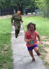 Young Girl Meme - photo of a terrified young girl running from a peacock becomes a