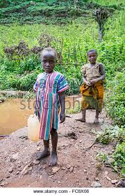 African Kid Meme Clean Water - african child drinking dirty water stock photos african child