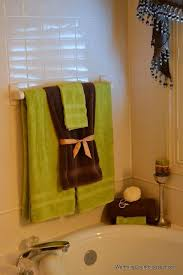 bathroom towel designs like this except gray for the big towels royal blue for the