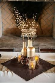 wine bottle wedding centerpieces diy black gold centerpieces spray painted wine bottles mod