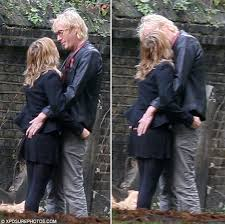 loved up sienna miller shares an intimate kiss with rhys ifans