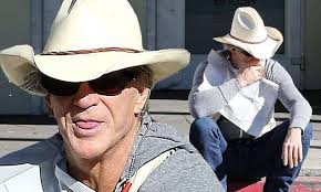 Mickey Rourke News Newslocker - mickey rourke steals a smoke while wearing a cowboy hat and boots
