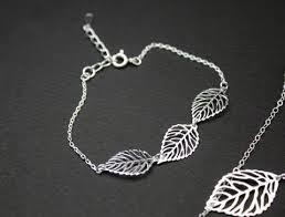 leaf charm bracelet images Tiny skull face charm pendant necklace in matt gold silver JPG