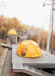 a platform for living u2014wooden structure and dome tents for sleeping