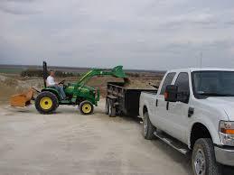 haul tractor on dump trailer