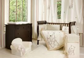 Nursery Interior Nuance Dark Brown Wooden Cradle With Cream Bedding Set Having Winnie The