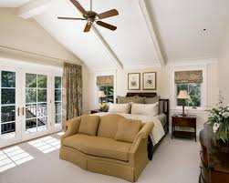 country style vaulted master bedroom ceiling with ceiling fan in a