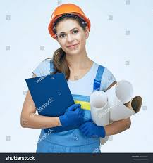 woman builder holding blueprints clipboard smiling stock photo