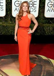 amy adams in orange dress with long curly hairstyles at golden