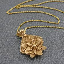 gold flower necklace designs images Stylized flower necklace handmade gold bronze metal clay pendant jpg