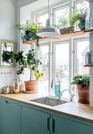 kitchen window shelf ideas green color palette reigns in this copenhagen home kitchen