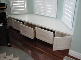 there was enough room for 3 deep drawers in the middle plus a built in bay window seat storage turned into drawers for easier accessibility i would love to turn the trunks into drawers like this