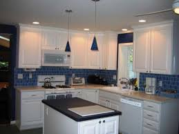 light white cabinets blue backsplash blue and gray kitchen