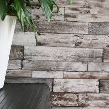 rustic planks wood effect wallpaper in brown grey and beige