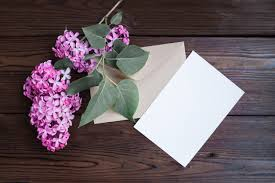 lilac flowers lilac flowers on wooden table photo free