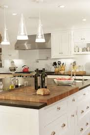 kitchen island cutting board spacious and stylish kitchen design with generous white shaker