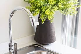 this plug and play faucet attachment reduces water use by 98