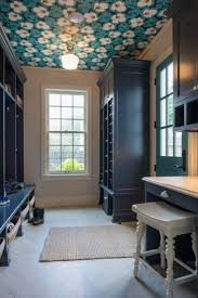 gorgeous blue mudroom with wallpapered ceiling mudroom design