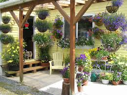 landscaping front porch ideas with wooden pergola and some flower