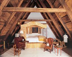 attic bedroom with canopy bed and exposed beams amazing wooden
