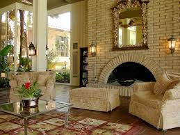 living room with sofas and wall sconces spanish style home