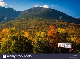 sign for the mount washington auto road and autumn color in the