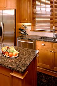 what color countertops go with brown cabinets 50 popular brown granite kitchen countertops design ideas