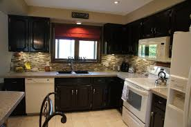 small kitchen design and decoration using white wood glass door