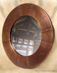 round hammered copper mirror frame with lapped and riveted seams