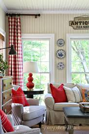 i love the pops of red especially the checked curtains in this