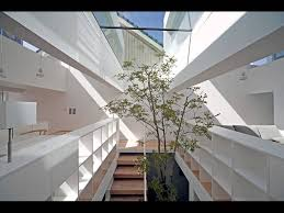 modern japanese townhouse design with inner garden and podium roof