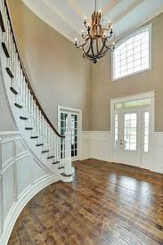 two story foyer with rustic large chandelier two story foyer