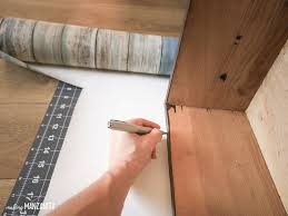 add peel and stick wallpaper to the sides of drawers