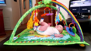 fisher price rainforest music and lights deluxe gym playset fisher price rainforest melodies lights deluxe gym review youtube
