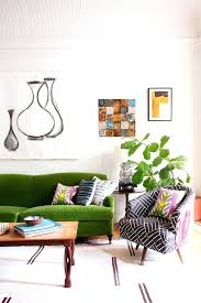 light green couch living room how to decorate a living room with dark green couch green couch