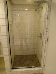 small shower stall with glass door and subway wall tile decofurnish