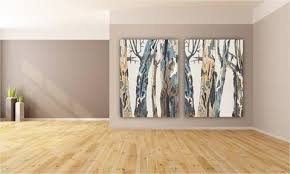 large wall white diptych set tree trunks oversized